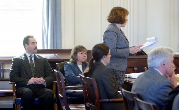 Natalie Burns (standing), an attorney representing the town of Kennebunk, addresses Justice Nancy Mills during a hearing in York County Superior Court in Alfred on Friday, Feb. 22, 2013. Seated (from left) is Kennebunk Police Chief Robert McKenzie, York County District Attorney Kathryn Slattery, Deputy District Attorney Justina McGettigan and defendant Mark Strong Sr.