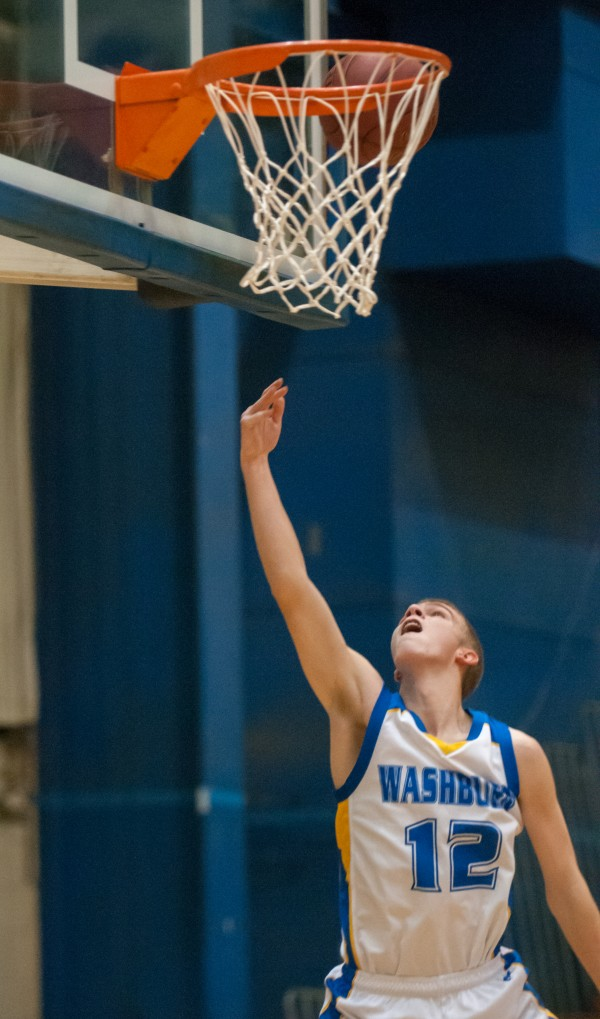 Washburn's Nicholas Bragg scores on a break away layup against Bangor Christian at the Bangor Auditorium on Monday, Feb. 18, 2013.