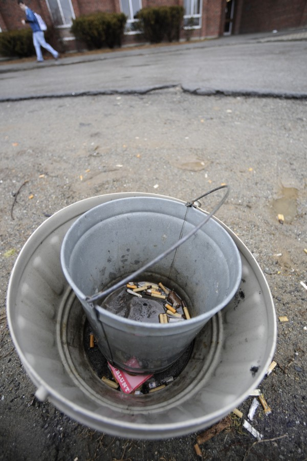Cigarettes were scattered inside and around a smoking product receptacle outside Oxford Hall at the University of Maine in Orono in February 2010. University officials have since adopted a tobacco-free campus policy.