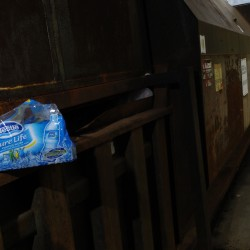Bottled water packaging is wedged into a Dumpster behind the Shaw's supermarket on Main Street in Bangor in 2010. A pair of men were spotted there after purchasing several cases of bottled water with food assistance money and then emptying the bottles in this holding dock area behind the supermarket so they could redeem the empty bottles for deposit money.