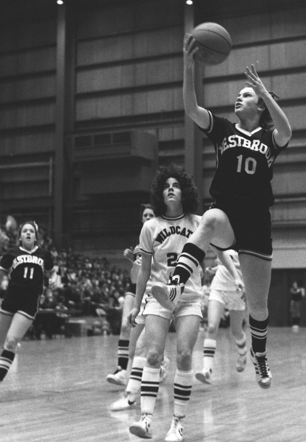 Lisa Blais of Westbrook breaks in alone for a fourth-quarter basket against Presque Isle in the Class A state final at the Bangor Auditorium on March 14, 1981. Presque Isle's Debbie Lennon trails the play. Blais scored 28 points in Westbrook's 61-59 win.