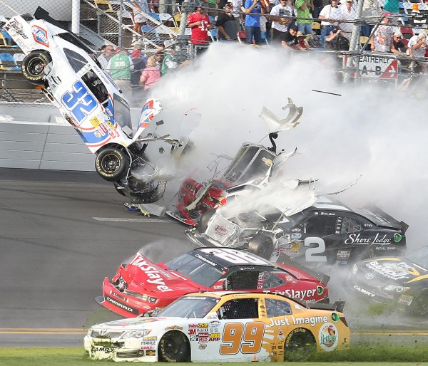 A crash involving the car of Kyle Larson (32) happened on the last lap of the DRIVE4COPD 300 Nationwide Series race at Daytona International Speedway in Daytona Beach, Fla., on Saturday, Feb. 23, 2013.
