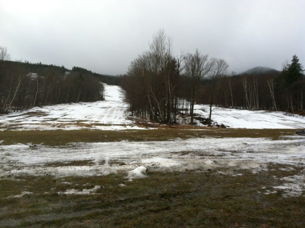 Warm weather and rain have caused green grass to show through many places of Squaw Mountain Ski Resort in Big Moose Township on Thursday, Jan. 31, 2013.
