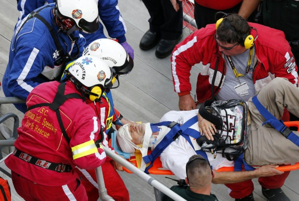 Rescue workers attend to the injured in the stands following a last-lap crash during the NASCAR Nationwide Series DRIVE4COPD 300 race at the Daytona International Speedway in Daytona Beach, Fla., on Feb. 23, 2013.