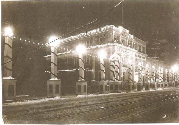 "Merrill Trust Company and a section of the ""White Way,"" stretching from Exchange Street to Bangor''s old City Hall at Hammond and Columbia streets, as they appeared lit up for the city''s Food Fair and Winter Carnival in 1913."