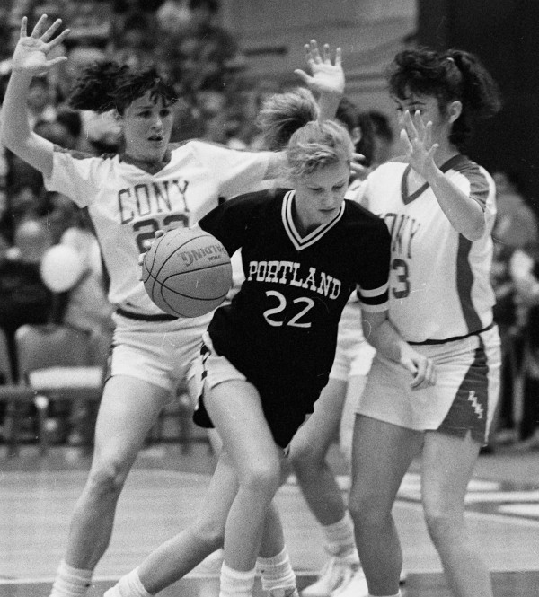 Portland's Sharon Bay attempts to drive past Cony's Becky Demos (left) and Christine Tschamler during the Class A state final at the Bangor Auditorium on March 18, 1989. Cony edged Portland 59-57.
