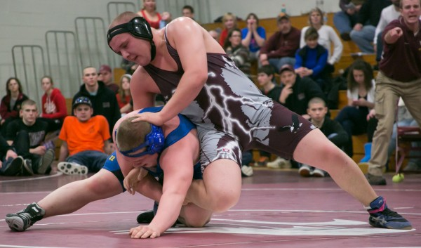 Ellsworth High School's Micheal Garland (right) wrestles against Hermon High School's Alex Urquart in the 220-pound championship match at the Eastern Maine Class B wrestling regional championship on Saturday, Feb. 2, 2013.