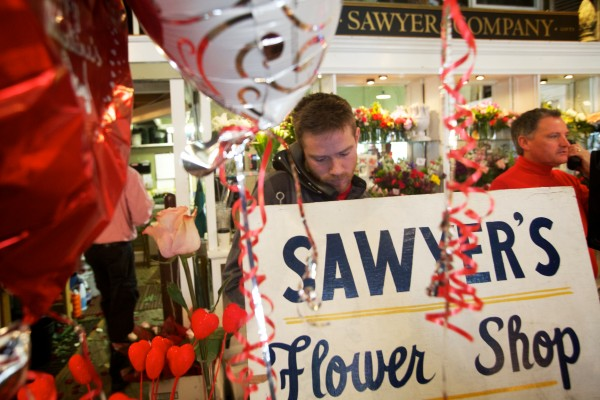 John Sundling (left) and Dan Kennedy work the phones Thursday, Feb. 14, 2013 at Sawyer & Co., a flower shop on Congress Street in Portland. Kennedy recently purchased Minott's Flowers with an SBA-backed loan.