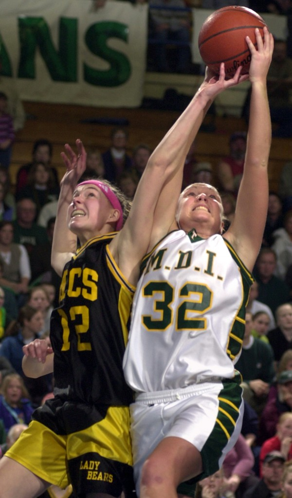 Mount Desert Island's Shelley Gott (right) battles for a rebound with Kim Denbow of Maranacook during Saturday's Eastern Maine Class B final at the Bangor Auditorium on Feb. 23, 2003. MDI beat Maranacook and went on to beat Greely for its third straight state title.