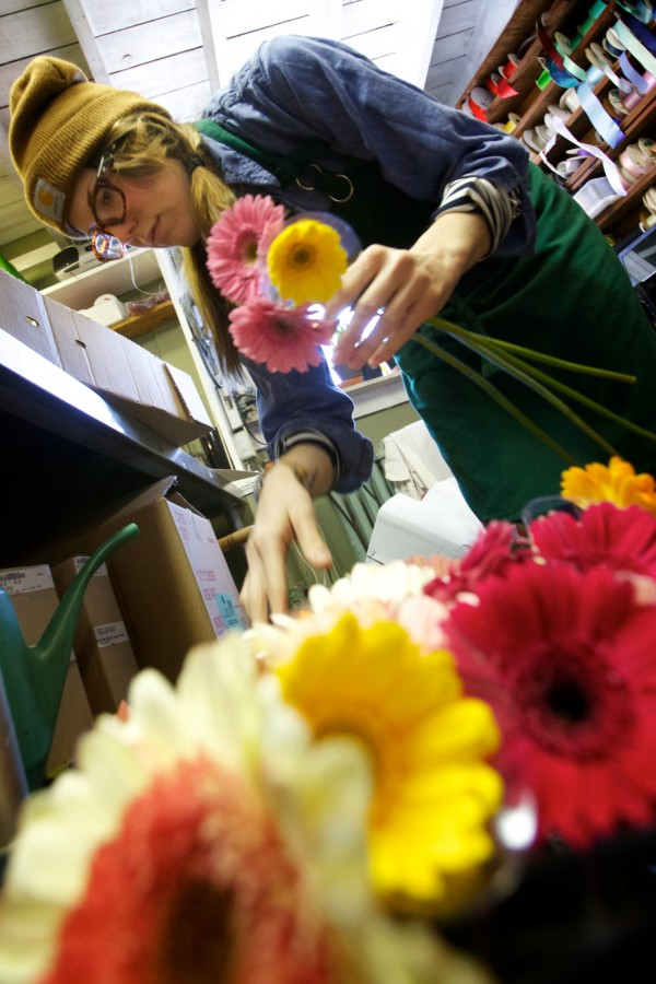Sawyer & Co. floral designer Dee Clements selects daisies Thursday, Feb. 14, 2013 on Congress Street in Portland.