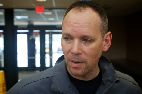 During a stop at the Kennebunk rest stop on the Maine Turnpike Wednesday, University of Maine women's basketball coach Richard Barron speaks about the crash that wrecked his team's bus Tuesday night.