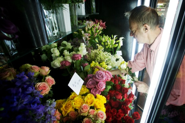 Sawyer & Co. floral designer Erik Anthony selects flowers from the cooler Thursday, Feb. 14, 2013 on Congress Street in Portland. Owner Kennedy recently purchased Minott's Flowers with an SBA-backed loan.