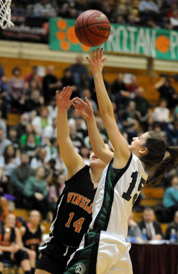 MDI's Bailey Burr goes up for a shot over Winslow defender Meg Nadeau in first-half action of their quarterfinal game Saturday morning at the Bangor Auditorium.