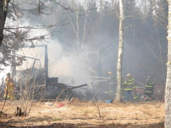 Fire fighters worked Friday afternoon to extinguish a blaze that demolished a home on Savery Road in Searsport. The man and woman who were at the residence escaped without injury, officials said.