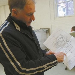 Project manager Don Borkowski holds architectural drawings of the Longfellow Arts Building floor plans in this photo published Feb. 5, 2012.