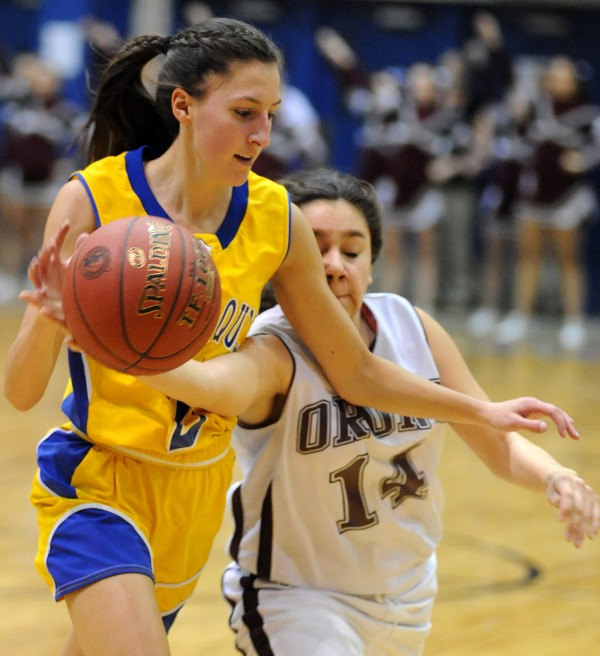 Orono's Jordan Hernandez (right) tries to strip the ball from Piscataquis' Alex Speed during their girls Class C quarterfinal game Tuesday morning, Feb. 19, 2013, at the Bangor Auditorium. Orono won the game 45-40 in overtime.