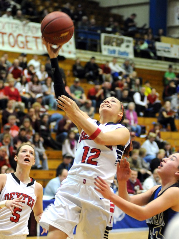 Dexter's Alison Pease goes up for a shot in first-half action of the Class C girls quarterfinal game Tuesday morning, Feb. 19, 2013, at the Bangor Auditorium. Dexter won the game 38-36.