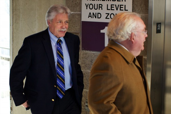 Defendant Mark Strong (left) and defense attorney Daniel Lilley leave the Cumberland County Courthouse Friday Jan. 18, 2013 after a judge said Lilley could not withdraw from the case in which Strong faces multiple charges including promotion of prostitution.