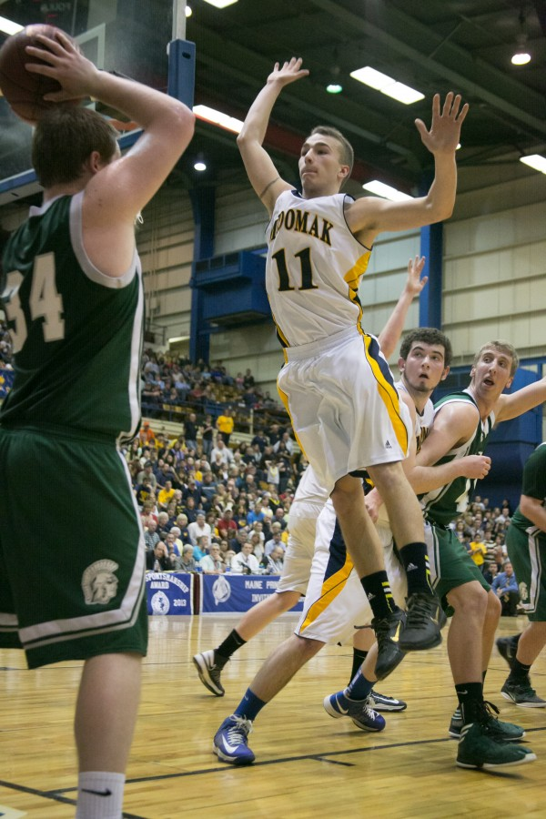 Medomak Valley's Brandon Soper (center) tries to defend an inbound pass from Mount Desert Island's Ben Walls (left) during the Eastern Maine Class B title game at the Bangor Auditorium on Saturday, Feb. 23, 2013.