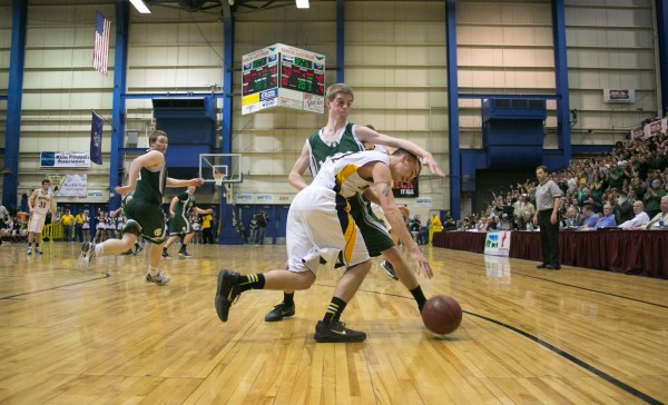 Medomak Valley's Brandon Soper (front) tries to dribble around Mount Desert Island's Jonathan Phelps (back) during the Eastern Maine Class B title game at the Bangor Auditorium on Saturday, Feb. 23, 2013.