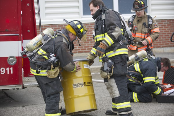 Orono hazardous material crews carry a salvage drum into Hitchner Hall at the University of Maine in Orono after responding to a &quotchlorine cloud&quot at 12:15 a.m. Thursday afternoon.