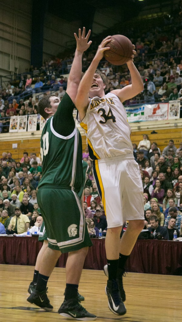 Mount Desert Island's Adam Gray (left) defends Medomak Valley's John Murray (right) during the Eastern Maine Class B title game at the Bangor Auditorium on Saturday. Murray has been named the Eastern Maine Class B tourney MVP.