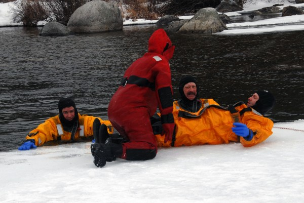 Passadumkeag Fire Department firefighter Nicholas Rossignol and Lowell Fire Department firefighter Hollis Langley (both far right) were among several firefighters who practiced ice water rescue operations at Cold Stream Pond on Sunday, Feb. 24, 2013.