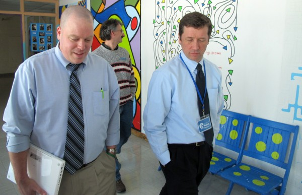 Maine Department of Education Commissioner Stephen Bowen (right) takes a tour of Deer Isle-Stonington High School on Monday, Feb. 25, 2013, with Principal Todd West (left) and state Rep. Walter Kumiega, D-Deer Isle (background).