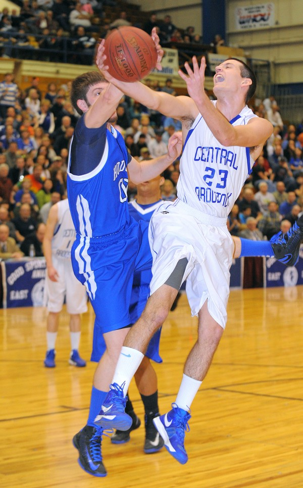 Central Aroostook's Steven Decker (right) is fouled by Hodgdon's Devin Logie during the first half of the Eastern Maine Class D final in Bangor Saturday. Decker has been named the Eastern Maine Class D tourney MVP.