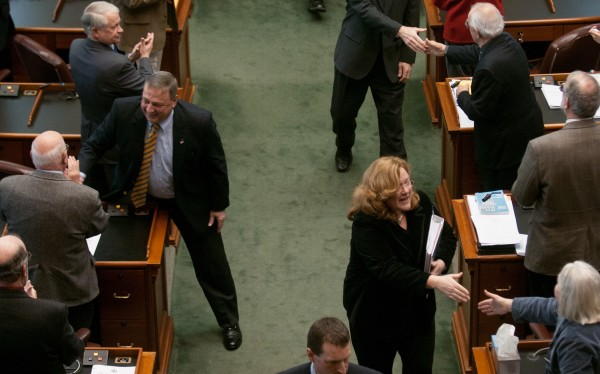 Gov. Paul LePage (center left) and Leigh Ingalls Saufley (right), Maine Supreme Court chief justice, shake hands as they exit the State House chamber after Saufley gave the State of the Judiciary address on Thursday, Feb. 21, 2013.