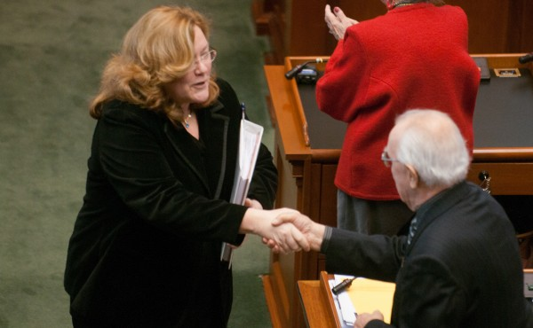 Leigh Ingalls Saufley, Maine Supreme Judicial Court chief justice, shakes hands as she exits the State House chamber after giving the State of the Judiciary address on Thursday, Feb. 21, 2013.