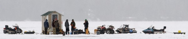 After ice fishing traps are set, fishermen wait for action at an ice shack on Beech Hill Pond in Otis Saturday, during the Maineiac Charities Ice Fishing Derby. The Derby also includes all legal bodies of water in Hancock County.