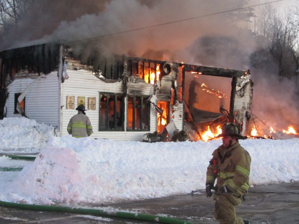 Firefighters from Owls Head and South Thomaston battle a Sunday evening blaze that destroyed a landmark Owls Head business, Frankie's Garage.