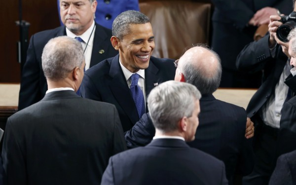 President Barack Obama (center) talks with Secretary of the Interior Ken Salazar at the conclusion his State of the Union Speech on Capitol Hill in Washington on Feb. 12, 2013.