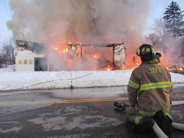 Firefighters from Owls Head and South Thomaston battle Sunday evening a blaze that destroyed a landmark Owls Head business, Frankie's Garage.