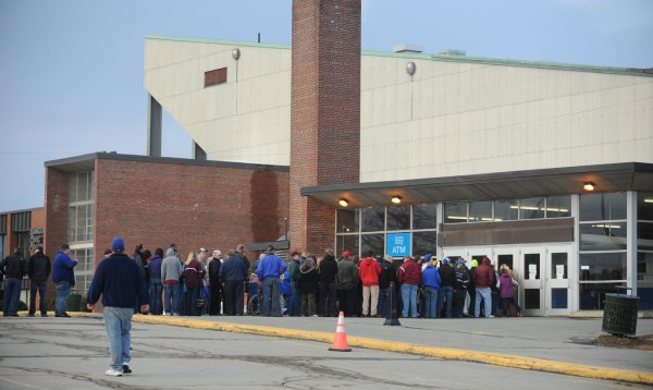 A line forms outside the Bangor Auditorium on Friday, Feb. 15, 2013 as the start of the final high school basketball tournament season at the old facility is set to tip off.