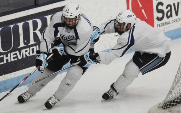 UMaine hockey players Steven Swavely (left) and his brother Jon Swavely skate during practice on Thursday, Feb. 7, 2013 at Alfond Arena in Orono. UMaine players have suffered seven concussions so far this year, which is up from an average of two to three head injuries over the past years.