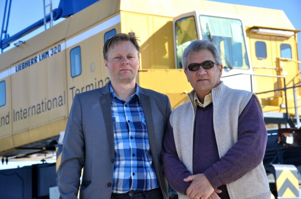 An Icelandic company, Eimskip, will begin offering direct container shipping service between Portland and northern Europe. Pictured here at Portland's International Marine Terminal are Larus Isfeld (left), Eimskip's senior manager in North America, and Jack Humeniuk, a local representative of the International Longshoremen's Association, the labor union representing workers at the terminal.