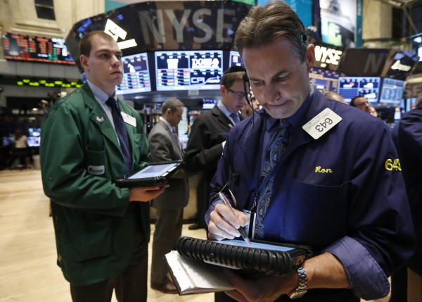 Traders work on the floor of the New York Stock Exchange, February 15, 2013.