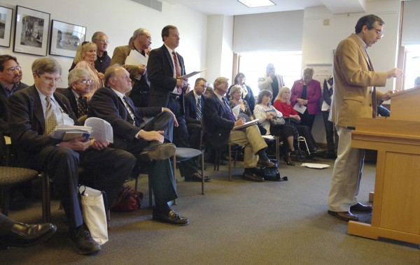 Opponents of a bill to modernize Maine tax laws wait for a chance to speak as Albert DiMillo Jr. (right) speaks against it at the State House in Augusta in April 2009.