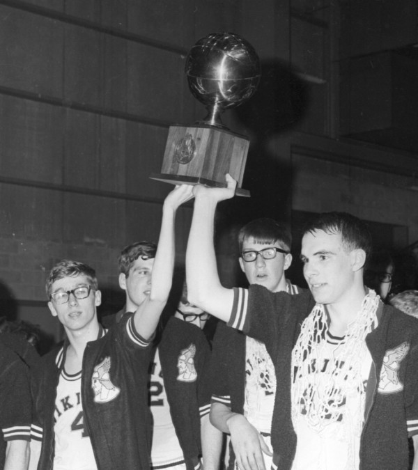 Caribou's Mike Thurston (left) and Mike Kelley show off the gold ball after the Vikings beat Westbrook for the Class LL title at the Bangor Auditorium on March 8, 1969.