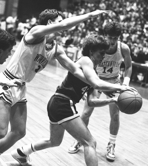 Lawrence's Matt Harris (center) is pressured by Waterville's Eric Browne (left) and Dick Whitmore during the Eastern Maine Class A final on March 10, 1986 at the Bangor Auditorium. No. 7 Lawrence beat No. 1 Waterville 56-53 in overtime.