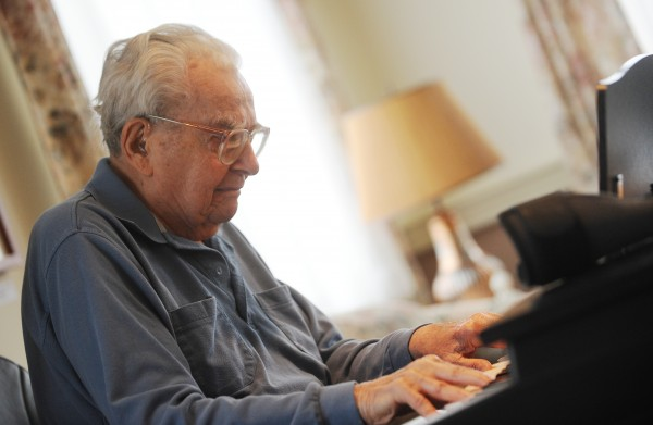 Sitting in his electric wheelchair at Boyd Place in Bangor on Thursday while playing piano, Harry Weiss says his arthritis prevents him from playing as he did as a young man. Weiss, a former silent movie musician, now plays piano for the pure love of it.