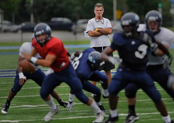 University of Maine head football coach Jack Cosgrove watches his Black Bear team in an intrasquad scrimmage on Morse Field on Aug. 15, 2011.