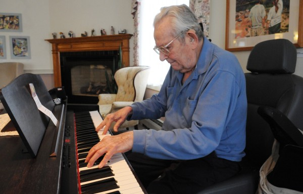 Sitting in his electric wheelchair at Boyd Place in Bangor on Thursday while playing piano, Harry Weiss says his arthritis prevents him from playing as he did as a young man.