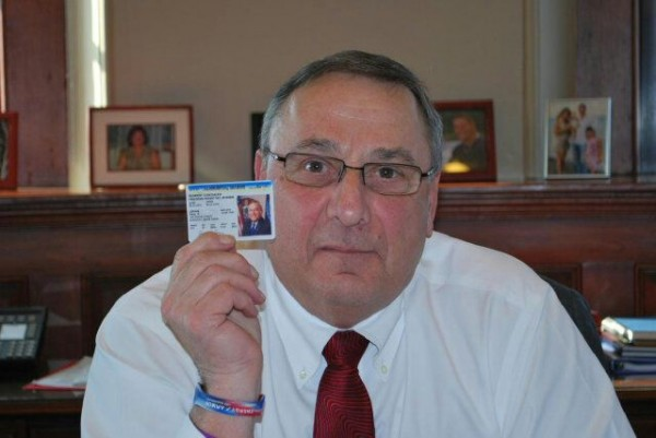 Gov. Paul LePage displays his concealed weapons permit in this photograph released by his office on Thursday, Feb. 14, 2013.