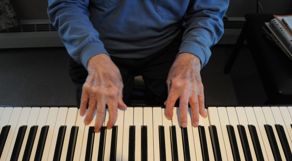 The 95-year-old fingers of Harry Weiss tickle the ivories of an electronic keyboard at Boyd Place in Bangor on Thursday.