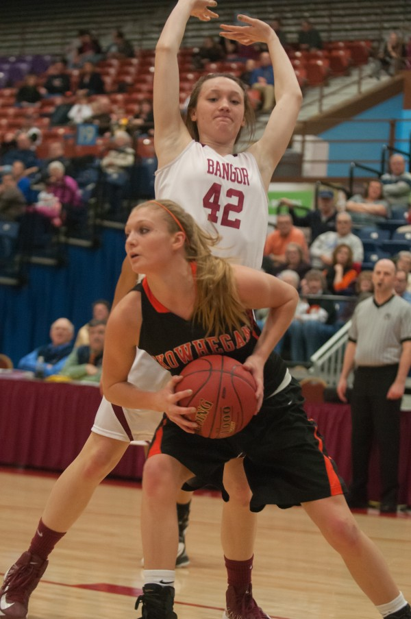 Skowhegan's Adriana Martineau (front) snags a rebound from Bangor's Mary Butler at the Augusta Civic Center on Friday, Feb. 15, 2013.
