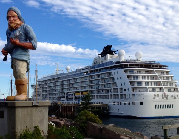 The World, the world's largest privately owned yacht, docked in Eastport in October 2012. The World is honoring Chris Brown, a local Eastport businessman and volunteer who helped coordinate the ship's visit, for excellence in service.
