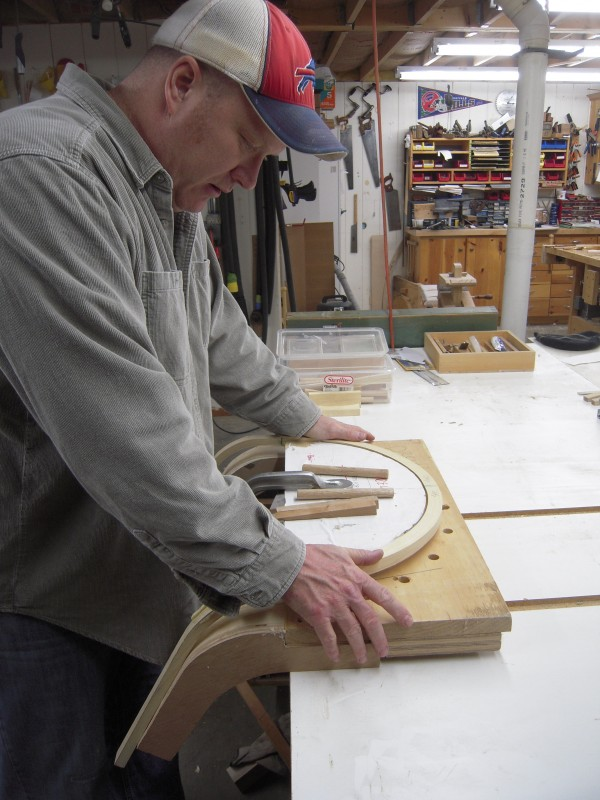 Once the ash for a chair back is steamed it must be bent into shape quickly before it dries, says Terry Kelly, who makes Shaker and Windsor furniture at his home in Mapleton.